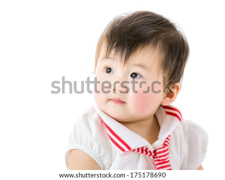 Asian baby girl looking at a side