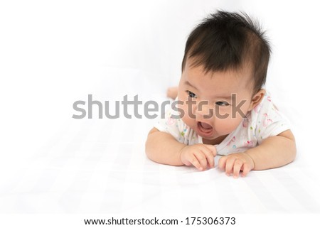 Asian baby girl on isolated background