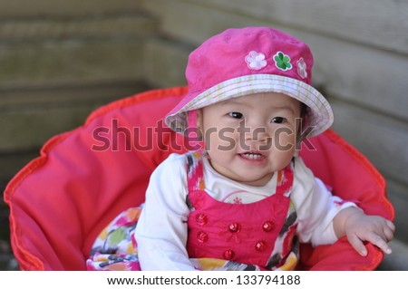 Asian baby girl smiling - stock photo