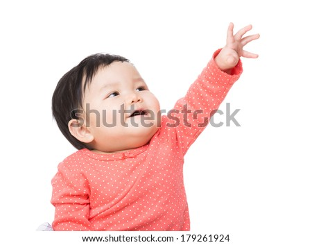 Asian baby girl touch top - stock photo