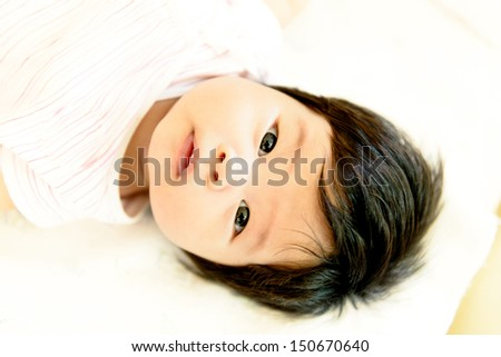 Asian baby  girl. Viewed from above - stock photo