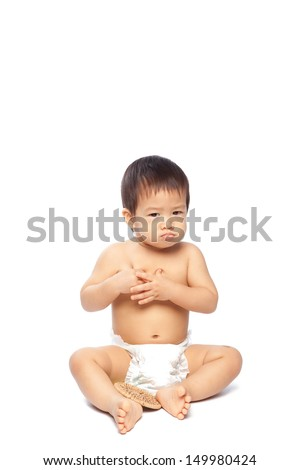 Asian baby holding on his chest isolate on white background - stock photo