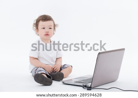 Asian baby seeming to be future businessman. Child in white T-shirt and curly hair isolated on white. - stock photo