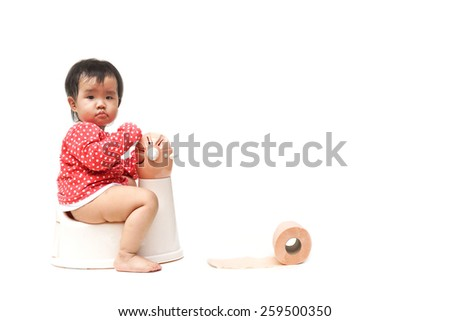 asian baby using and playing with toilet - stock photo