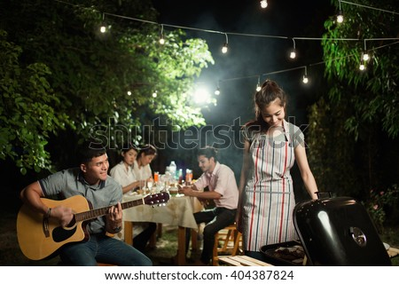 Asian barbecue party men are singing their friends.at night - stock photo