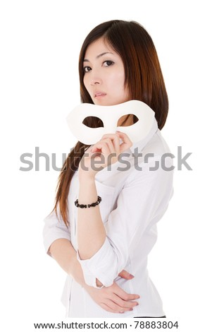 Asian beautiful business woman holding a mask and looking at you, half length closeup portrait on white background. - stock photo