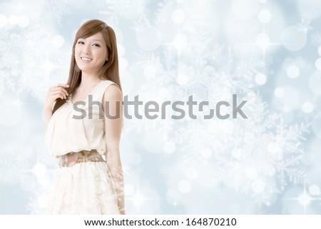 Asian beauty, closeup portrait on Christmas shiny background. - stock photo