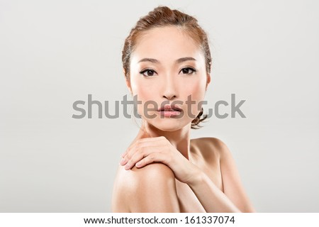 Asian beauty face closeup portrait with clean and fresh elegant lady in studio gray background. - stock photo