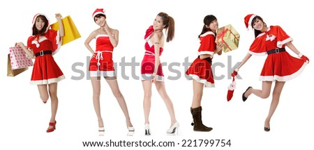 Asian beauty in Santa Claus dress with bag posing against white background. - stock photo