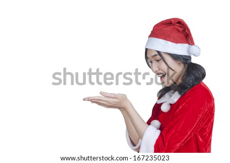 Asian beauty with Santa Claus dress, closeup portrait on white.