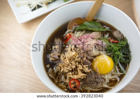 Asian beef pho noodle soup, rice noodles and vegetables. close-up. top view          - stock photo
