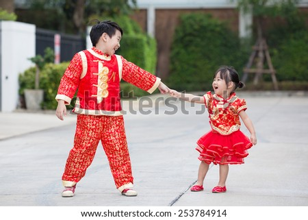 asian boy and girl in chinese clothes - stock photo