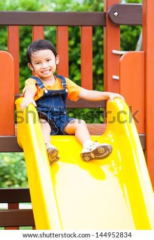 asian boy enjoy playground outdoor - stock photo