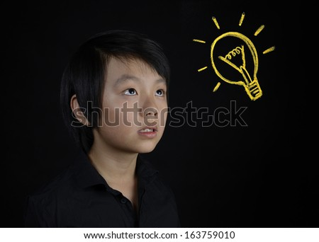 Asian boy has an idea (eureka moment) - stock photo