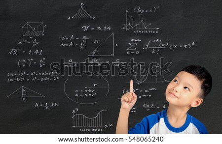 Asian boy holding a finger math geometry formulas on black background.