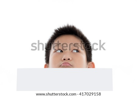 Asian boy holding white board and looking up, isolated on white - stock photo