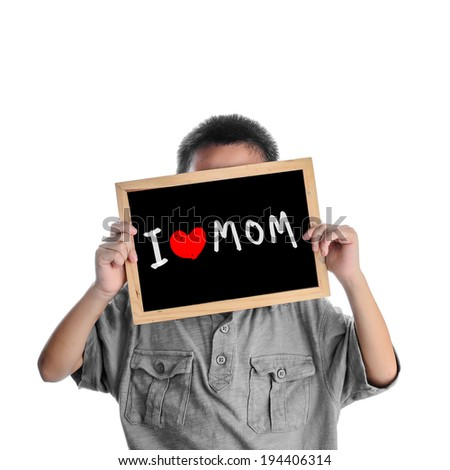 Asian boy holding with love Mom message on black board - stock photo