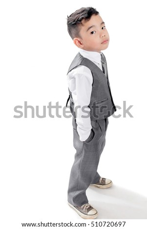 Asian boy in a nice suit on white background,Little boy in a nice suit