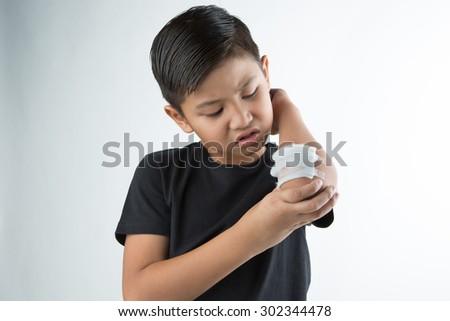 Asian boy injury on his arm - stock photo