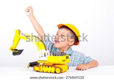 asian boy joyful with toy, little engineer concept - stock photo
