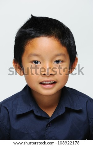 Asian boy looking at camera and smiling