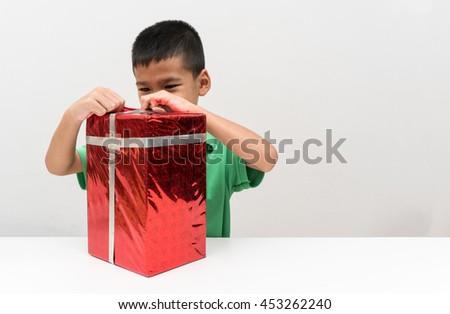 asian boy open birthday surprise gift box - stock photo