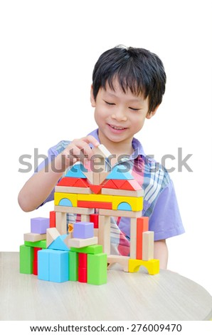 Asian boy playing blocks on table over white background