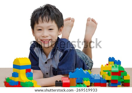 Asian boy playing blocks on the floor