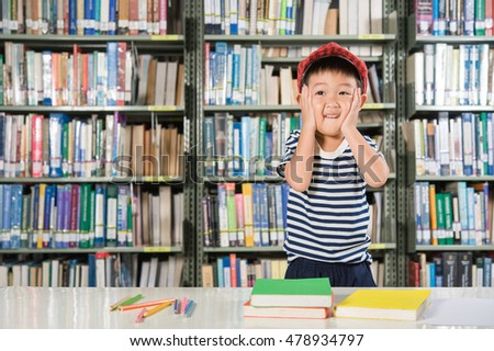 Asian Boy playing in library room school