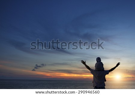 Asian boy playing in sunset,nice view