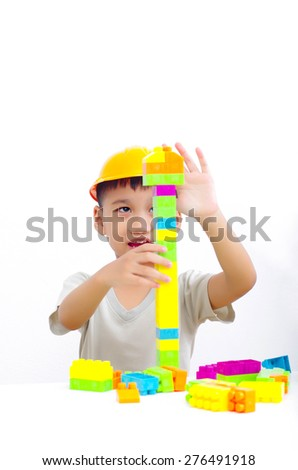 asian boy playing plastic brick, little engineer concept - stock photo