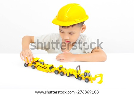 asian boy playing truck toy, little engineer concept - stock photo