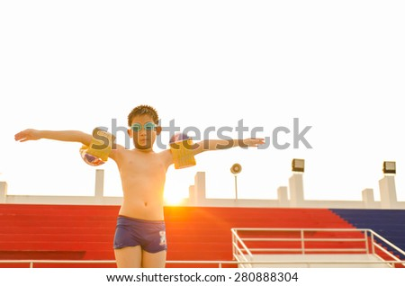 Asian boy prepare to  jumping in the swimming pool - stock photo