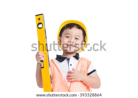 Asian boy pretending to be a construction worker. Isolated over white background. - stock photo