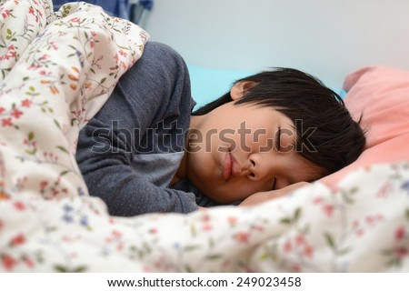 Asian boy sleeping - stock photo