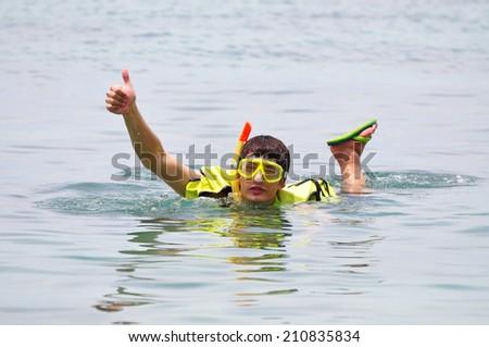 Asian Boy Snorkeling - stock photo