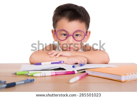 asian boy student to do homework at a table on a white background