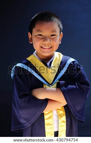 Asian boy ware graduation suit. Selective focus.
