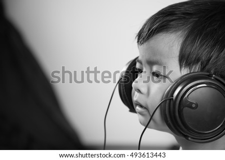 Asian boy ware headphone black and white image