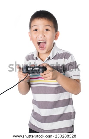 Asian boy with a joystick playing video games, isolated on white background.