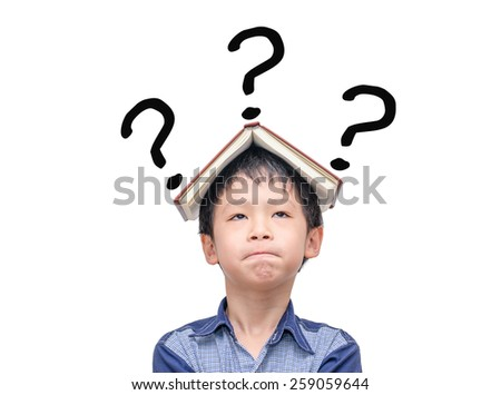 Asian boy with book on head thinking with question marks over white - stock photo