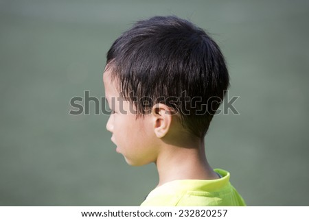 Asian boy with sweated hair after sport
