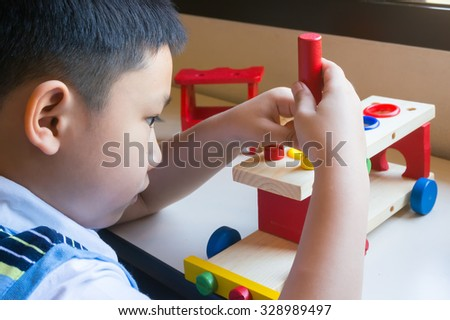 Asian Boy With Wooden Toy Colorful Truck