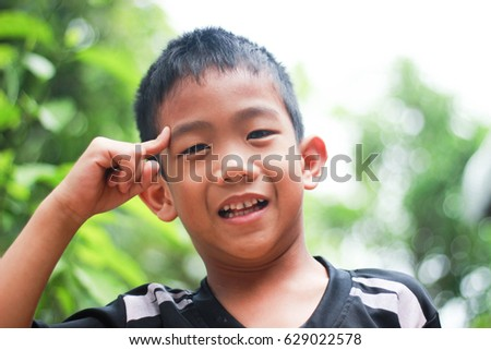 Asian boys make cute gestures and smile sincerely handsome. Is using ideas.