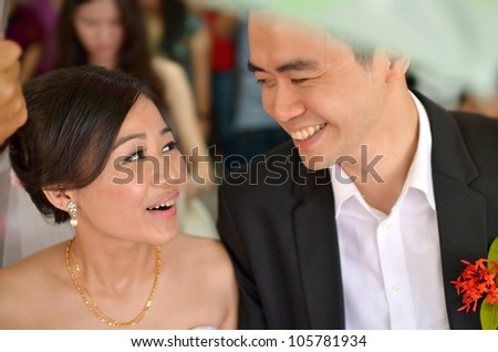 asian bride during their actual day wedding ,focus on bride's eyes