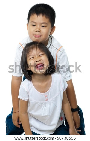 Asian brother and sister on white background - stock photo