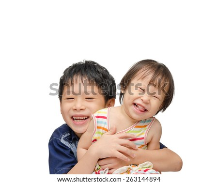 Asian brother and sister smiling over white background - stock photo