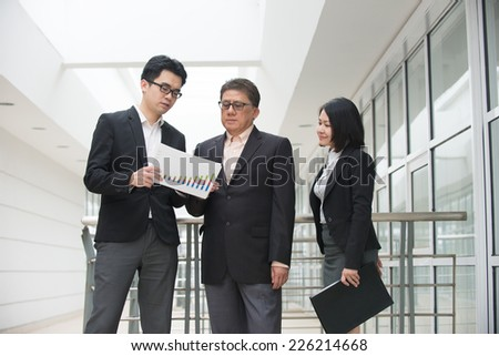 asian busines team outdoor meeting - stock photo