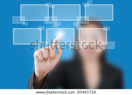Asian business lady pushing button on the whiteboard. - stock photo