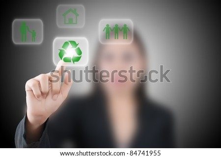 Asian business lady pushing recycle icon on the whiteboard. - stock photo